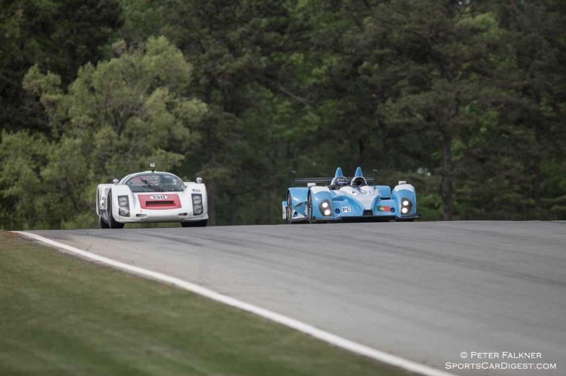 VRC Porsche and Oreca FLM crest the hill at turn 5