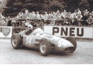 Sir Stirling Moss driving the Maserati 250F at Spa