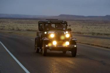 Rod Wade and co-driver Michael Flanders with their 1930 Ford Model A on the road at dusk