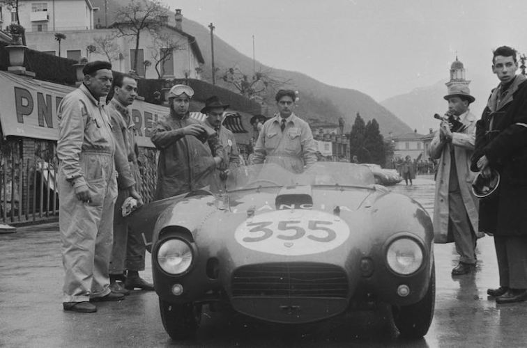 Alberto Ascari prepares for a demonstration run in a Lancia B24 sports racer at the 1954 Racing Driver's Course, Campione, Switzerland