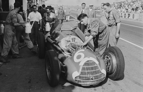 The action in the pits was oftentimes just as desirable an image as that from the track. In 1951, Mailander shows the Alfa Romeo 159, driven by Consalvo Sanesi receiving some tinkering in the pits at the French Grand Prix, Reims.
