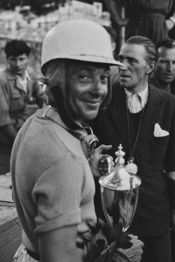Mailander's work is regarded for the way he captured the people in addition to the cars of his time. Robert Mazon, clutching the trophy, appears to smile here specifically for Mailander's lens at the 1952 Monaco Grand Prix.