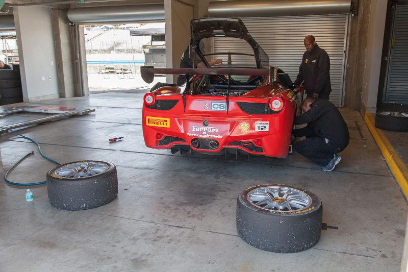 Brakes and suspension being checked on the #12 Ferrari 458 EVO