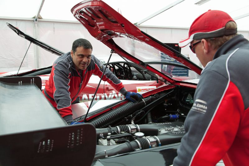 Ferrari of Beverly Hills crew member, William Cruz, going over some engine details of the 458 EVO engine