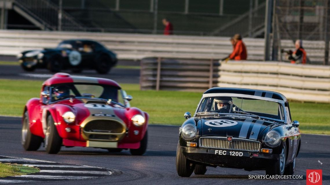 Driver of the MG A looks for the quickly approaching AC Cobra