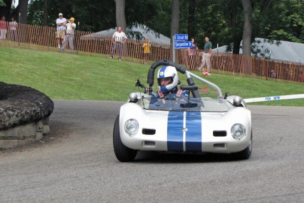 Group 6 winner Tom Grudovich corners hard in his 1961 Elva Mk VII