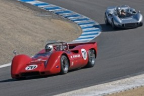 David Hankin's 1968 McLaren M6B leads Brad Hoyt in his 1966 McLaren M1B down the Corkscrew