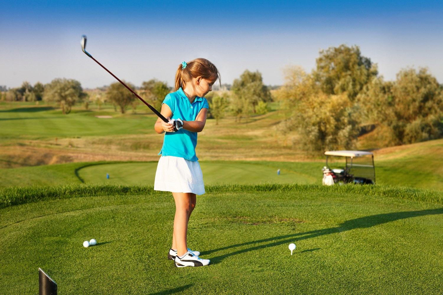 bigstock-cute-little-girl-playing-golf--92016296.jpg