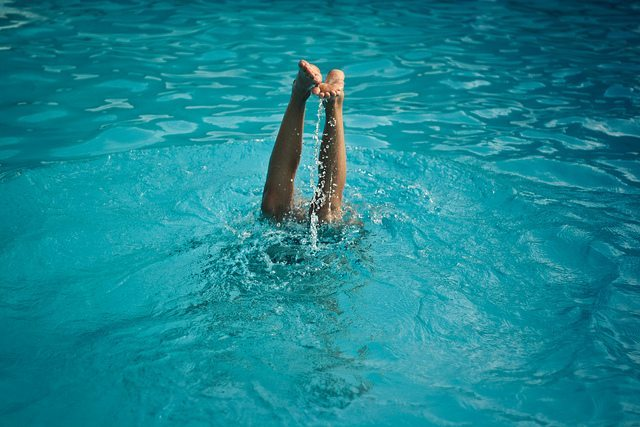 Letting go of the side of the pool