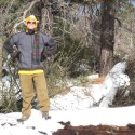 Tyler conquering the snowy log