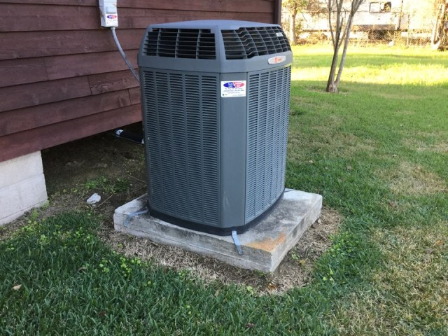 Santa Fe, TX - System not cooling. 6 year old system installed by Doctor Cool and Professor Heat. Outdoor unit repaired and system cooling properly again.