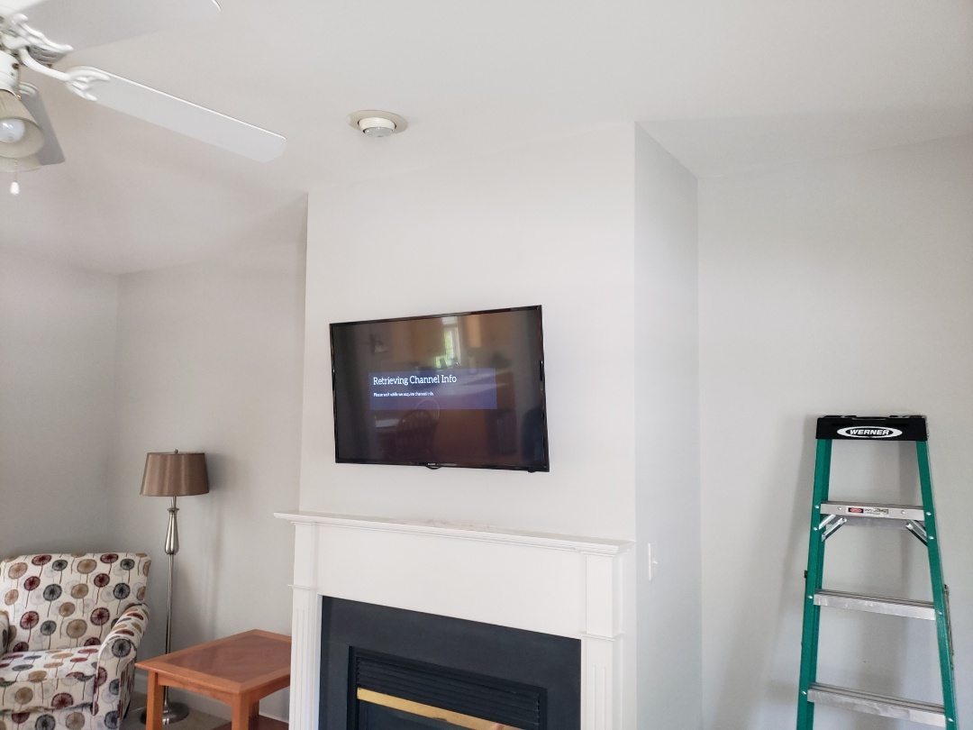 Wake Forest, NC - Mount TV above fireplace