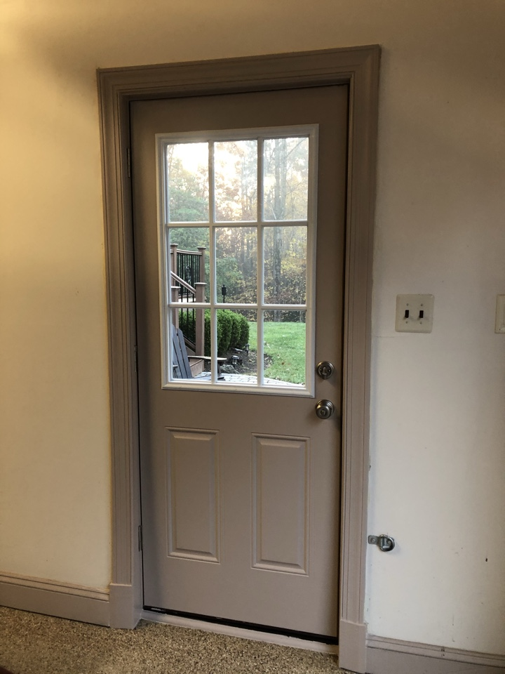 Davidsonville, MD - Installing weatherstripping on door final touch