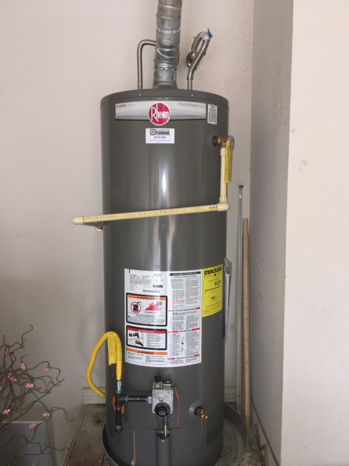 Allen, TX - Whirlpool gas water heater no hot water. Honeywell gas valve not operating properly. Whirlpool sent thermopile assembly that did not work. Installed new Rheem Professional water heater in garage.