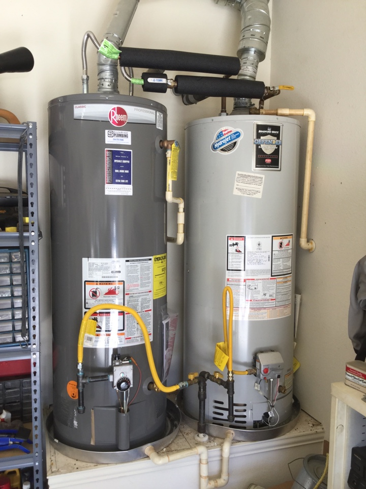 Forney, TX - Bradford white water heater leaking in garage, left side unit. Install new Rheem Professional water heater with 10 year warranty