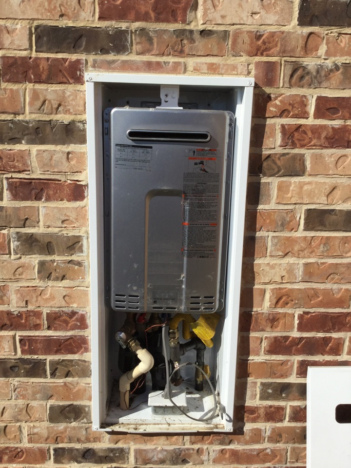 Royse City, TX - Tankless water heater on outside wall needs maintenance. Perform tankless water heater inspection and tankless maintenance Royse city plumbers