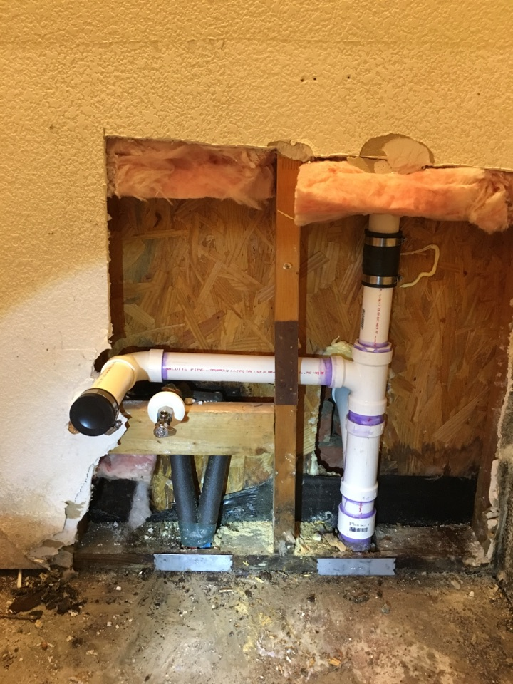 Rowlett, TX - Drain leak in wall when faucet is running. Open wall to expose leak. Found leak on pvc drain pipe. Install all new drain pipes in wall.