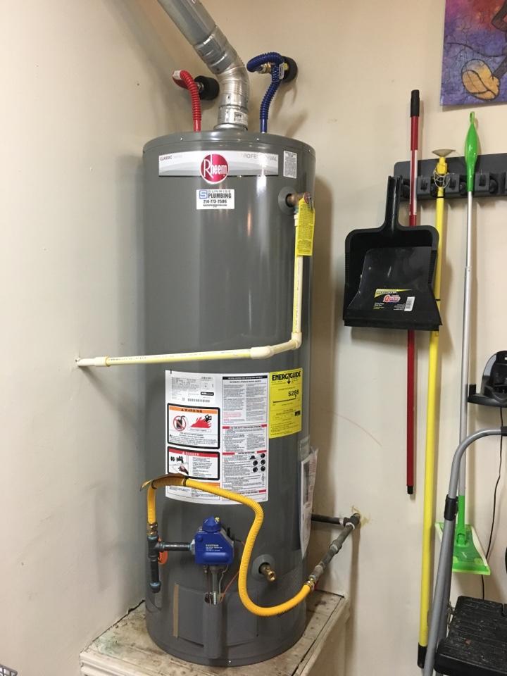 McKinney, TX - Water heater leaking in garage need repair or replacement. Install new Rheem gas water heater in garage. Sunrise Plumbing Mckinney Texas