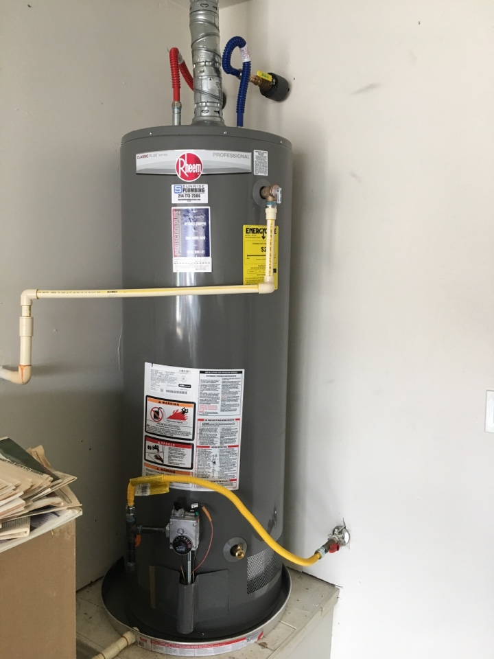 Rockwall, TX - Bradford white water heater 10 years old leaking in garage, needs replacement. Install new Rheem professional water heater with 12 year warranty.