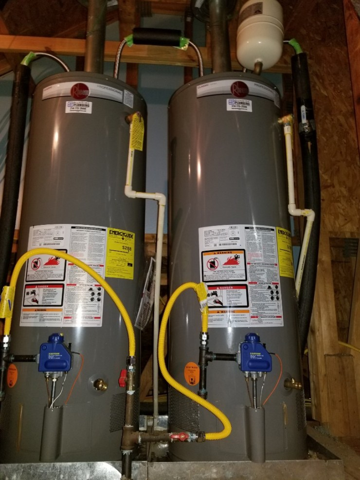 Frisco, TX - Water heaters leaking at top of units  Need repair. Install to new 50 gallon gas water heaters in attic