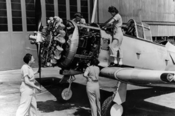 Quartet of female mechanics wrangling a radial engine