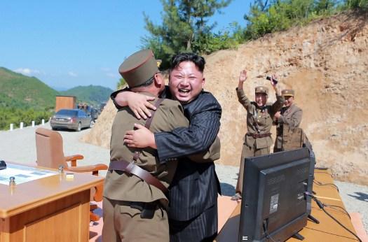 North Korean premier Kim Jong-un celebrates after the success of an earlier missile test.