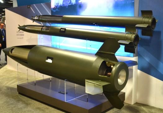 Models of Lockheed's GMLRS rockets, at top, and ATACMS missile.