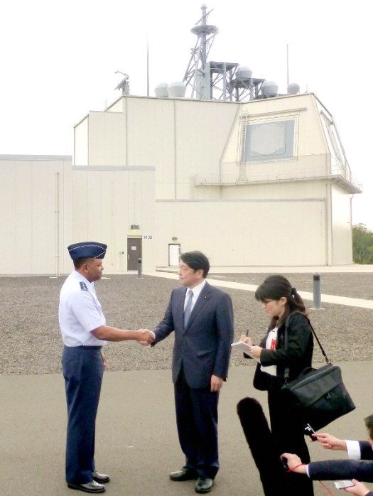 Japanese Defense Minister Itsunori Onodera, at center, shakes hands with an American military official at the Aegis Ashore Missile Defense Test Complex in Hawaii on Jan. 10, 2018.