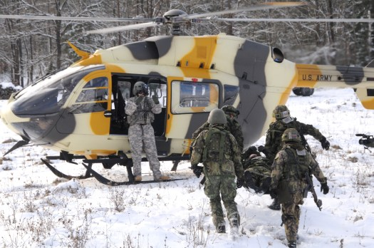 Bulgarian soldiers load a simulated casualty onto a US Army UH-72A Lakota helicopter wearing an unusual at the Joint Multinational Readiness Center in Germany.