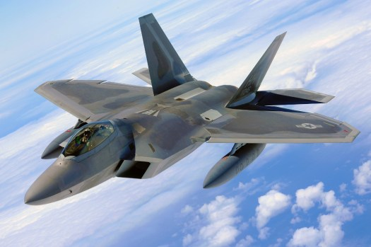 An F-22 with a pair of drop tanks.