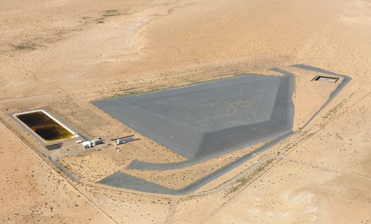 Tuba City Uranium Disposal Cell in Arizona, one of number of uranium tailings disposal sites in various configurations scattered around the country. Some sites have entire mills buried beneath them along with their tailings.<strong data-recalc-dims=