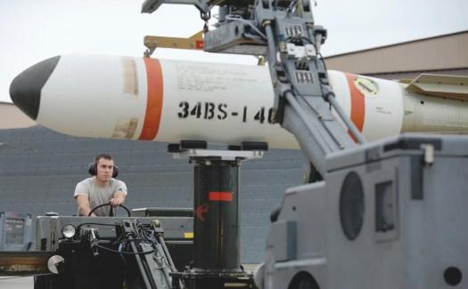 An airmen prepared to load a Mk 65 Quickstrike mine onto a B-1 bomber during a drill.