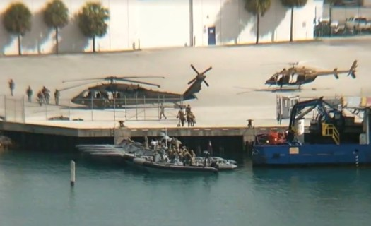 The scene at a dock at the Port of Maimi that Omen from Miami saw when he initially looked out his office window.