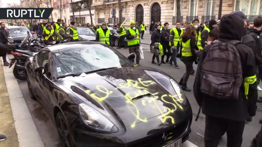 A Ferrari vandalized in Paris last weekend.