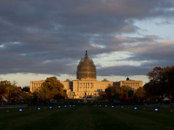 The sun sets on the U.S. Capitol Building on the National Mall in Washington. Photo: Wikimedia Commons.
