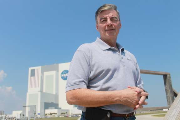 Space Day 2015 Chair Andy Allen stands in front of the Vehicle Assembly Building at Kennedy Space Center. Photo: Amy Green, WMFE