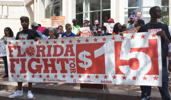 Orlando service workers want officials to consider a nearly $7 living wage increase. Photo: Renata Sago, WMFE.