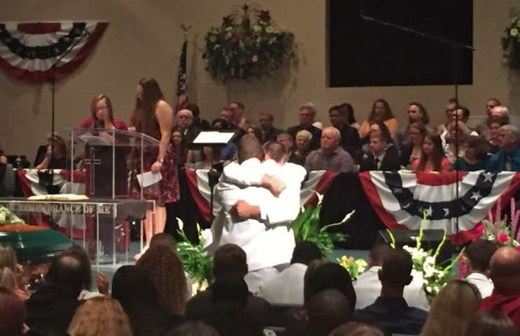 Ryan Connell, Cory's brother hugs close friend as his two sisters deliver eulogy at Saturday funeral.