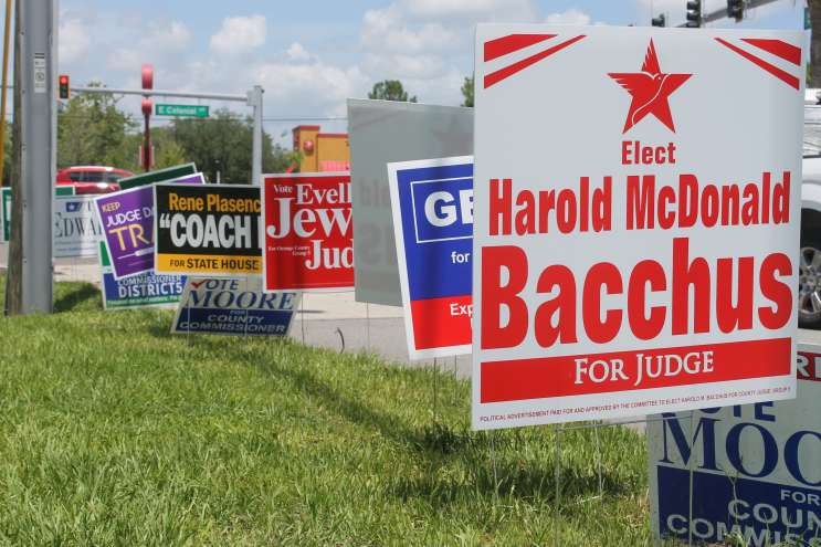 Campaign signs outside the Alafaya Library, one of Orange County's early voting sites. Photo: Matthew Peddie, WMFE