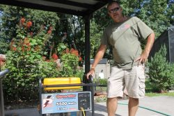 Gene Knight keeps his home running despite a power outage with his generator. Photo by Amy Green