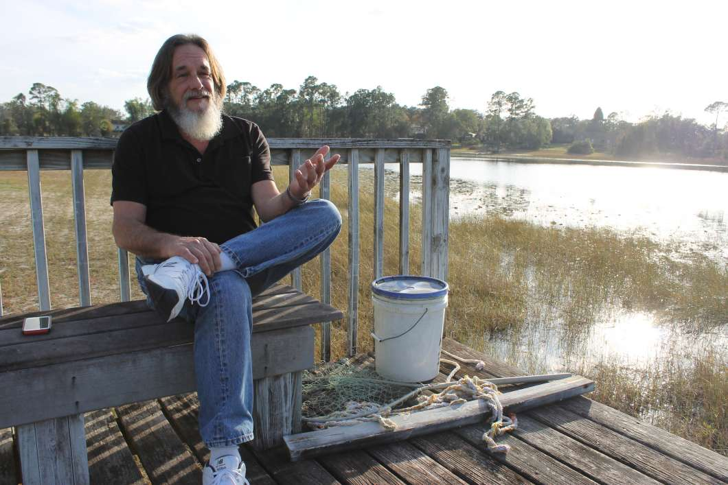 Reno Musatto on the dock of his Chuluota record label, Lakehouse Records. Photo: Matthew Peddie, WMFE