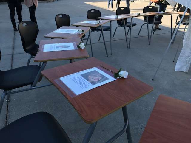 17 desks, one for each victim, at the Wekiva High memorial. Photo: Danielle Prieur