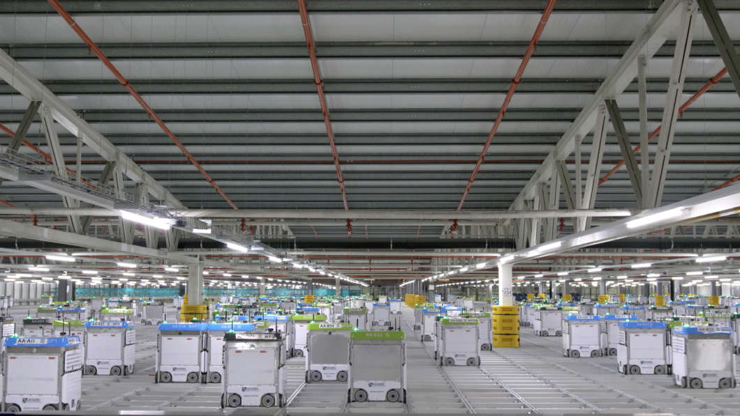 Photo of a prototype customer fulfillment center populated by by robotic equipment courtesy of Kroger, Ocado, and Lake County government