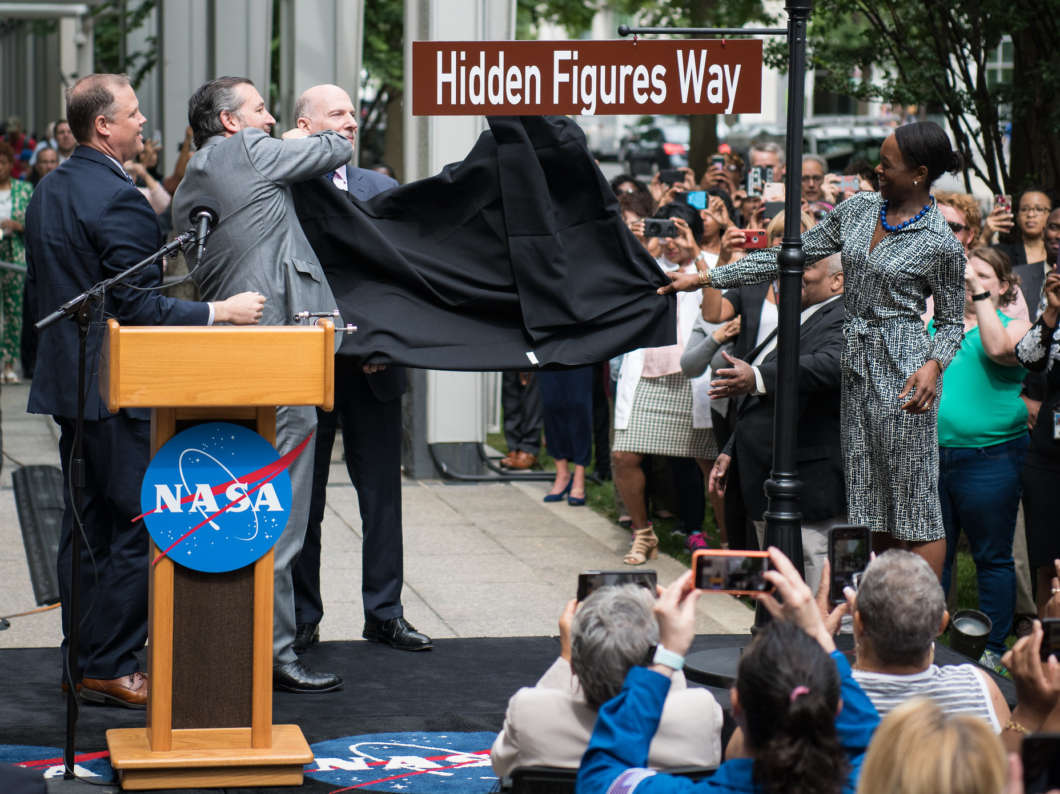 NASA Administrator Jim Bridenstine (from left), Sen. Ted Cruz, D.C. Council Chairman Phil Mendelson and Margot Lee Shetterly, author of the book Hidden Figures, unveil the Hidden Figures Way street sign at a dedication ceremony on Wednesday in Washington, D.C.
