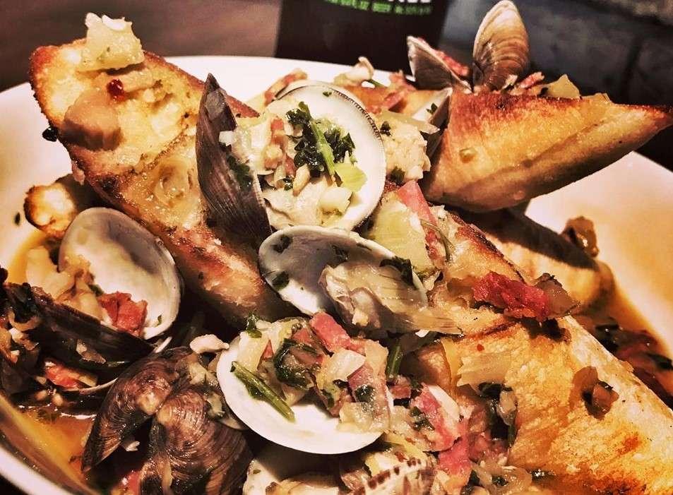Sette's Ciabatta Clam Toast with Soppressata. Photo courtesy of Sette on Facebook