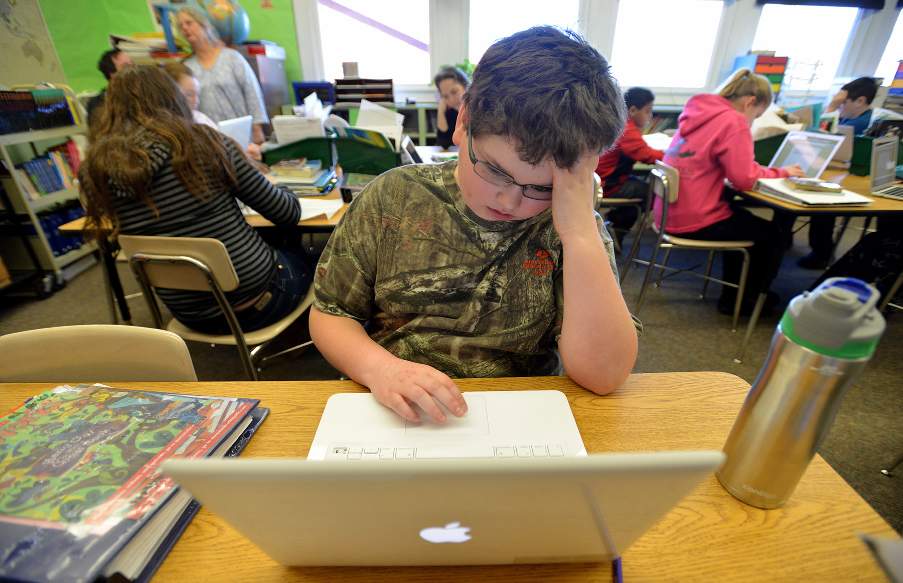 Myron Wotton, 11, Works on his arithmetic