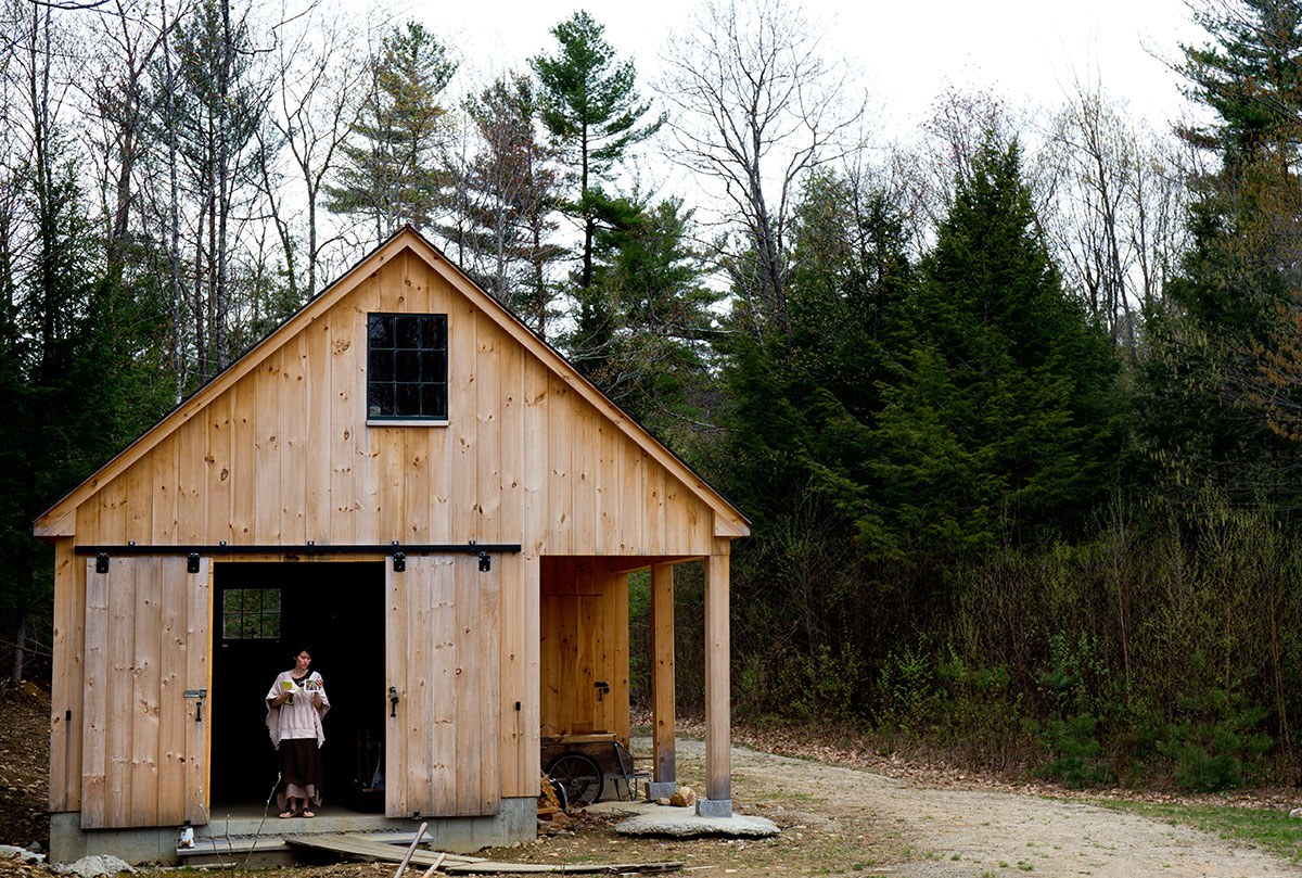 Amanda Sisk, of Dover, New Hampshire stops by the barn at Church of the Woods after arriving for Earth Day festivities.