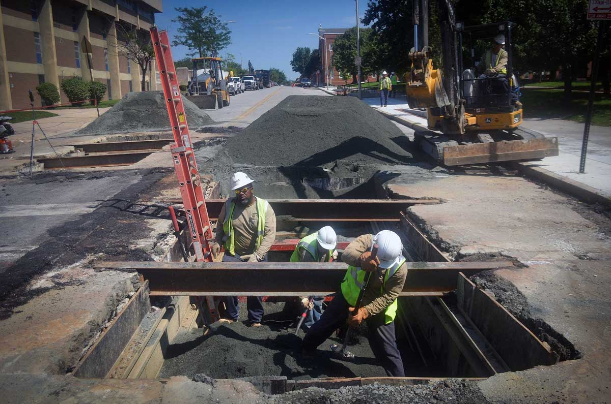 BGE workers are seen making upgrades to an underground natural gas pipe in Baltimore's Franklin Square neighborhood on July 31, 2017.