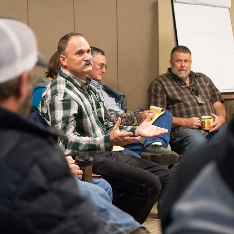 Paul Hessburg answers questions during an afternoon meeting with community leaders. Reception to his ideas ranged from welcome solutions to extreme skepticism. (Adam Bacher)