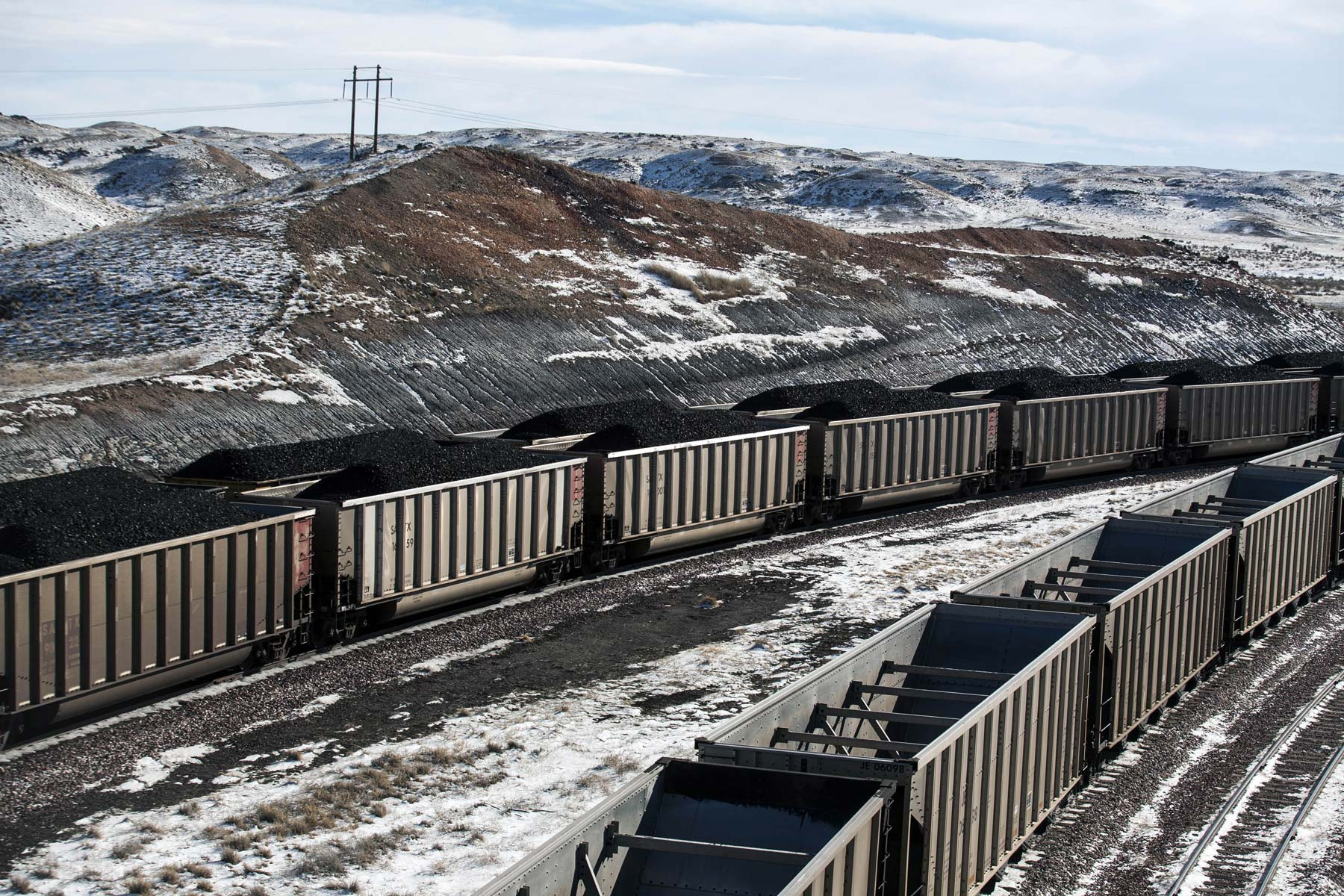In this Jan. 9, 2014, file photo, rail cars are filled with coal and sprayed with a topper agent to suppress dust at Cloud Peak Energy's Antelope Mine north of Douglas, Wyo. (Ryan Dorgan/The Casper Star-Tribune via AP)